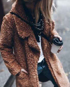OMG This coat looks so cozy!! AND it's faux fur, can it get any better???