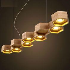 suspension bois design par Pilke Light en forme nid d'abeilles à 9 alvéoles hexagonales