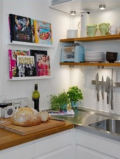 Creative Small Kitchen Ideas | Decozilla. Love this for recipe books and love the clean white walls and lighting.