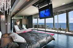 Don't like the room but this is EXACTLY how i want my bed to be oriented in a perfect world, with a tv that comes out of the ceiling, facing a wall of glass doors that will accordion to the side so the entire wall can be open.... to a pool :)