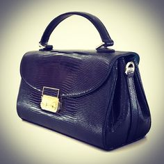 Exquisite n beautiful classic satchel crafted with M lizard leather.