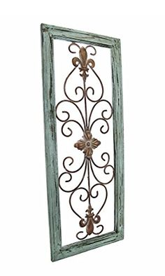 Outdoor wrought iron Fleur de Lis  wall decor with distressed Wooden Green Frame is a beautiful piece for any garden.