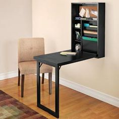 by Design Solutions  Fold-Out Convertible Desk, Wall Mounted Folding Desk - $229.00   It looks like a simple, non-intrusive wall cabinet, but this folds down into a desk. It would make a great space-saving workspace for my laptop,