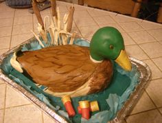 Mallard Duck - This is my 3rd Mallard duck cake, rice krispy treats for the tail and head , all covered in fondant. Cattails tootsie rolls on scewers rolled in cocoa.
