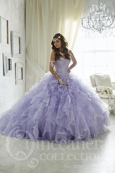 Make an unforgettable entrance in this extravagant quinceañera gown encrusted with beads and flowing with sparkling tulle ruffles. Lace-up back. Download the Quinceanera Collection by House of Wu sizi