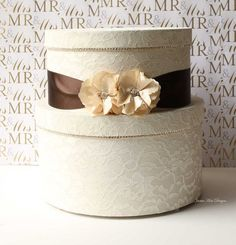 Lace Wedding Card Box: This creamy wedding card box ($125) is covered with pretty lace and decorated with brown satin ribbons.