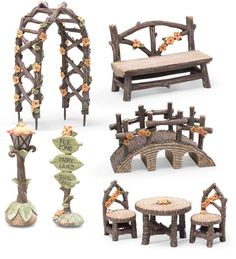 FlyZone Fairyland 8-Piece Fairy Garden Accessory Set includes fairy sized table and chairs, bench, arbor, bridge, sign and a lamppost that really lights up.