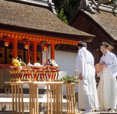 https://flic.kr/p/tyLBSp   Young Shinto priests prepare food offerings  in front of a shrine in the Fushimi-Inari temple, Kyoto