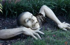 Awesome garden ornament! http://themostcoolgadgets.com/crawling-zombie-garden-ornament/