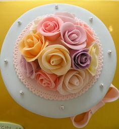 Roses on Cake. this one is also super pretty!!