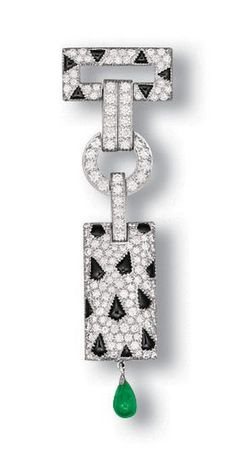 A DIAMOND, ONYX AND EMERALD 'PANTHÈRE' CLIP BROOCH, BY CARTIER Designed as a pavé-set diamond and onyx openwork surmount, to the brilliant-cut diamond links, suspending a pavé-set diamond and onyx plaque with a drop-shaped emerald terminal, mounted in 18k white gold, 7.2 cm long, with French assay marks for gold, in a Cartier red leather case Signed Cartier