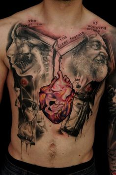 Awesome full chest tattoo. Love the heart.