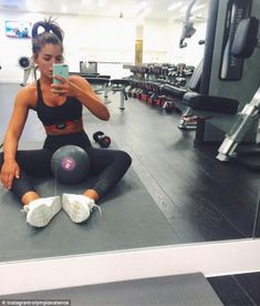 Showing Greg what he's missing? Olympia Valance showed off her fit physique in black crop top and matching yoga pants in impressive post-gym selfie on Friday