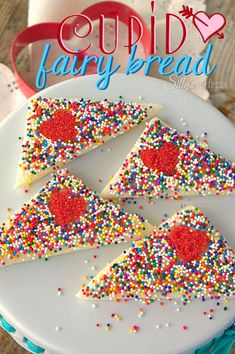 Cupid Fairy Bread, white bread smeared with homemade honey butter and topped with sprinkles for a yummy Valentine's day snack!
