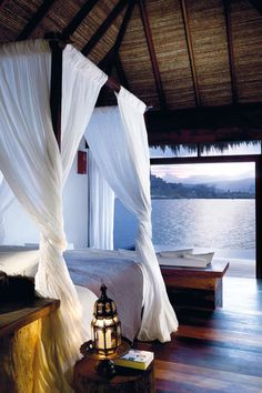 Yes to the bed and palapa roof, with white wood floors instead