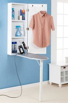 Mounted Storage Units: Or go for this prettier all-in-one ironing station that everything you need all together but out of sight. Click through for more laundry room organization ideas!