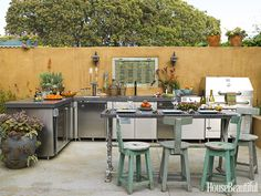 Designer Sandy Koepke used salvaged material and earthy colors to give this outdoor kitchen in Manhattan Beach, California, some age and maturity.
