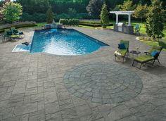 Add a circle pattern to your pavingstone pool patio. Cambridge Pavingstones with Armortec offers circle design kits. www.stonecreationsoflongisland.net