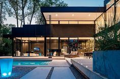 A 2-storey modern house situated on a wooded lot in Oakville, Ontario, designed by Guido Costantino. (Photo by Peter Sellar)