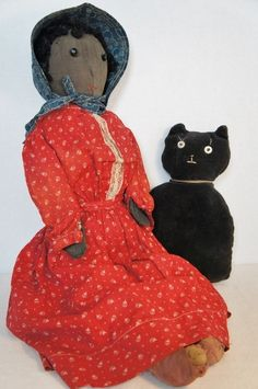 Big antique black cloth doll with red calico dress