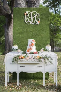 Dessert Display with a Floral Wall and Monogram | Shelly Taylor Photography | Southern Peach Wedding