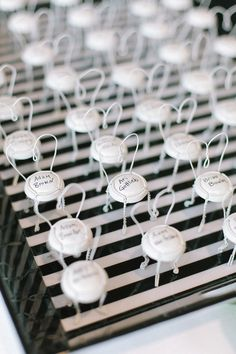 Champagne topper wire chair name cards, adorable! Photography by rutheileenphotography.com  Read more - http://www.stylemepretty.com/2013/08/20/new-bedford-wedding-from-ruth-eileen-photography/