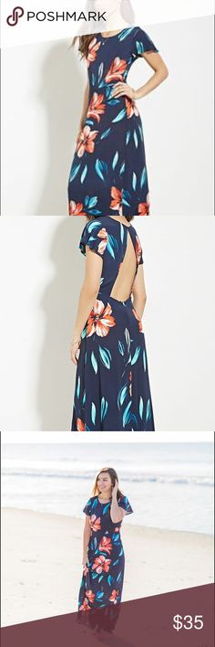 Navy and peach floral maxi with open back Beautiful navy maxi with peach, blush, and coral flowers. Open back with cap sleeves. Polyester material. I wore it once for my engagement photo shoot. Perfect for vacationing, date night, beach trip! Dresses Maxi
