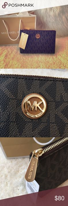 """Michael Kors Pouch New with Tags. in Excellent Condition! Never used! Brown gold tone travel pouch. Top zip closure. One slip pocket inside. Interior fully lined. H 5.25"""", L 8"""", W 2"""". 💯 % AUTHENTIC! Comes with paper bag when purchase. Please see pictures. Michael Kors Bags"""