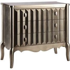 "Pairing a hand-painted golden bronze finish with 3 textured drawers, this eye-catching wood chest creates a striking focal point in your living room or master suite.     Product: ChestConstruction Material: Wood Color: Golden bronzeFeatures:  Hand-paintedThree drawersDimensions: 34"" H x 36"" W x 17"" D"