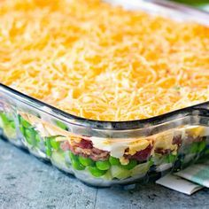 Traditional Seven Layer Salad with Iceberg Lettuce Frozen Peas Onion Celery Bacon Crumbles Hard Boiled Eggs Mayonnaise White Sugar Cheddar Cheese. by Read Gourmet Recipes, Cooking Recipes, Healthy Recipes, Easy Potluck Recipes, Cooking Games, Salad Bar, Soup And Salad, Seven Layer Salad, Frozen Peas