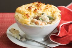 Freeze these elegant pies in individual baking dishes - then, once thawed, you can pop them straight in the oven. Seafood Pie Recipe, Seafood Pot Pie, Seafood Dishes, Fish And Seafood, Seafood Recipes, Cooking Recipes, Healthy Recipes, Cooking Ideas, Food Ideas