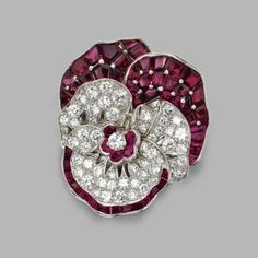 Diamond and ruby brooch pansy, Oscar Heyman & Brothers Inc.. Photo Sotheby's    Set with round diamonds Weighing Approximately 2.65 carats, and calibrated and round-cut rubies, mounted in platinum, maker's mark,