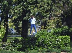 Duchess of Cambridge and Prince George walk around the lawns of Government House in Canberra during a break in their Australian tour. Douches Kate is talking to her son Prince George.