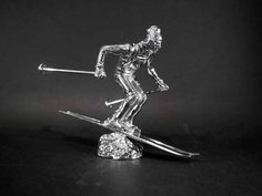 Silver Skier Louis Lejeune Ltd. Recent and archive photos of standard and bespoke car mascot/ hood ornament commissions.