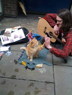 High Five - A streetcat named Bob, I read the book, wonderful story Momma wants to meet him next trip to London