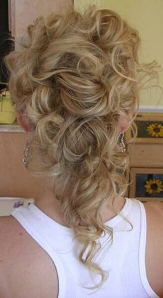 Back view of romantic updo, partially down.
