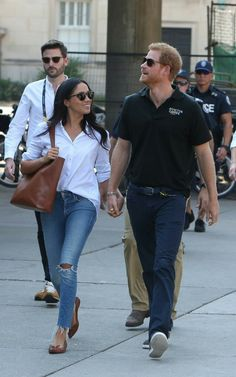Ms Markle and Prince Harry attend a tennis match at the Invictus games in Toronto