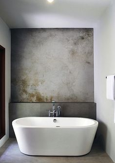 concrete & freestanding bath & shelf bathroom
