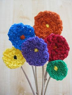 Finger Knitted Flowers: Fun and easy activity for even the young ones! You can hot glue them on the back to a piece of foam and make a beautiful bouquet!