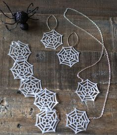 Make a fun, festive, and spooky jewelry set for the Halloween season with these Paper Spider Web DIY Jewelry pieces. Made from paper, this tutorial shows you how to make a necklace, bracelet, and pair of earrings in the shape of light-weight spider webs.