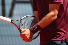 Aussie tennis player defends match point with the wrong end of the racket - If you're going to lose, do it with the style of a sullen teenager. Australian tennis player Bernard Tomic, 23, did just that.