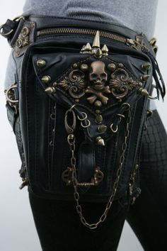 "Jungle Tribe: Skull Rocker Bag / ""the blaster bag pocket flap combined with the moneypenny body splattered with spikes, skulls and some antique badassery. yarrr"""