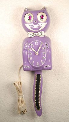 A purple version of my mom's clock.  I LOVED that clock as a kid but it was lost in our house fire.  This one is $280!!!