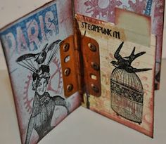 """Inside ATC using VLVS Hinge Tape to attache inside page! Stamps inside front: Paris Grunge, only lady from the Steampunk Couple stamp,   Stamps middle page front side: Flying Bird, Round Top Bird Cage and """"STEAMPUNK IT!"""""""