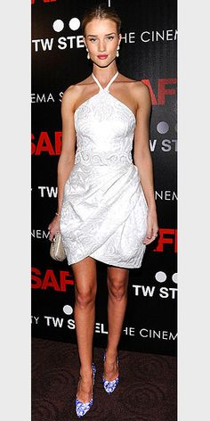 ROSIE HUNTINGTON-WHITELEY  For the N.Y.C. premiere of boyfriend Jason Statham's film Safe, the model picks a pretty white brocade Andrew Gn halter accented with colorful pumps and Miriam Haskell pearl earrings.