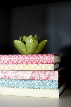 wrap books in papers that coordinate with your color scheme