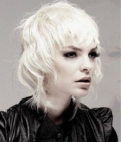 A medium blonde straight wavy shaggy coloured white hairstyle by Jamie Stevens. Love this!