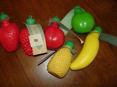 Little plastic fruit shaped containers filled with powdered sugar.
