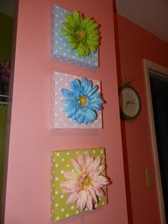 Flowers hot glued to canvases for nursery wall art