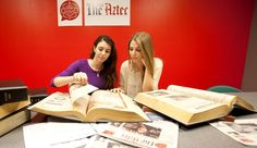 SDSU's student-run newspaper has provided the university with top-notch coverage for a century....The Daily Aztec News Editor Tara Millspaugh and Photo Editor Paige Nelson review old issues of the paper. (Photo by Antonio Zaragoza)